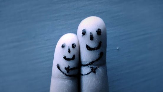 Close-Up Of Smiles Drawn On Fingers